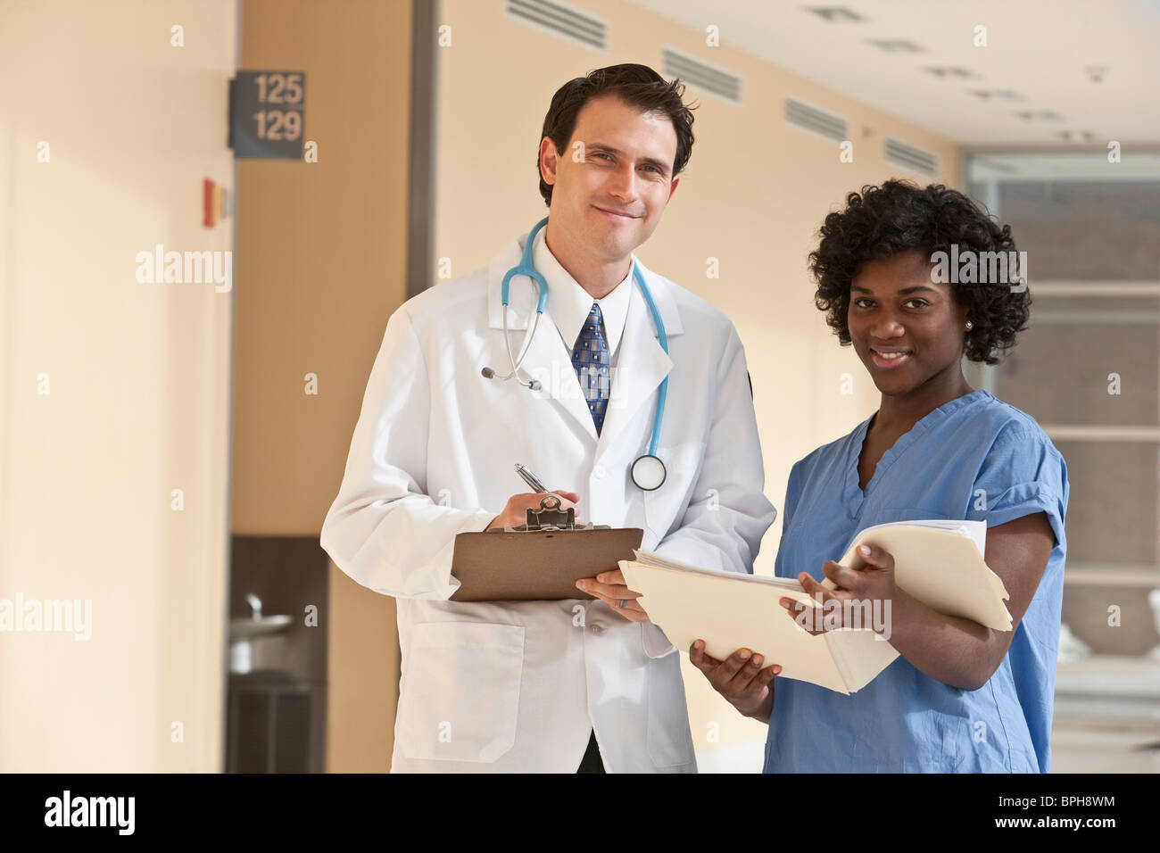 Doctor standing with a Jamaican female nurse Stock Photo