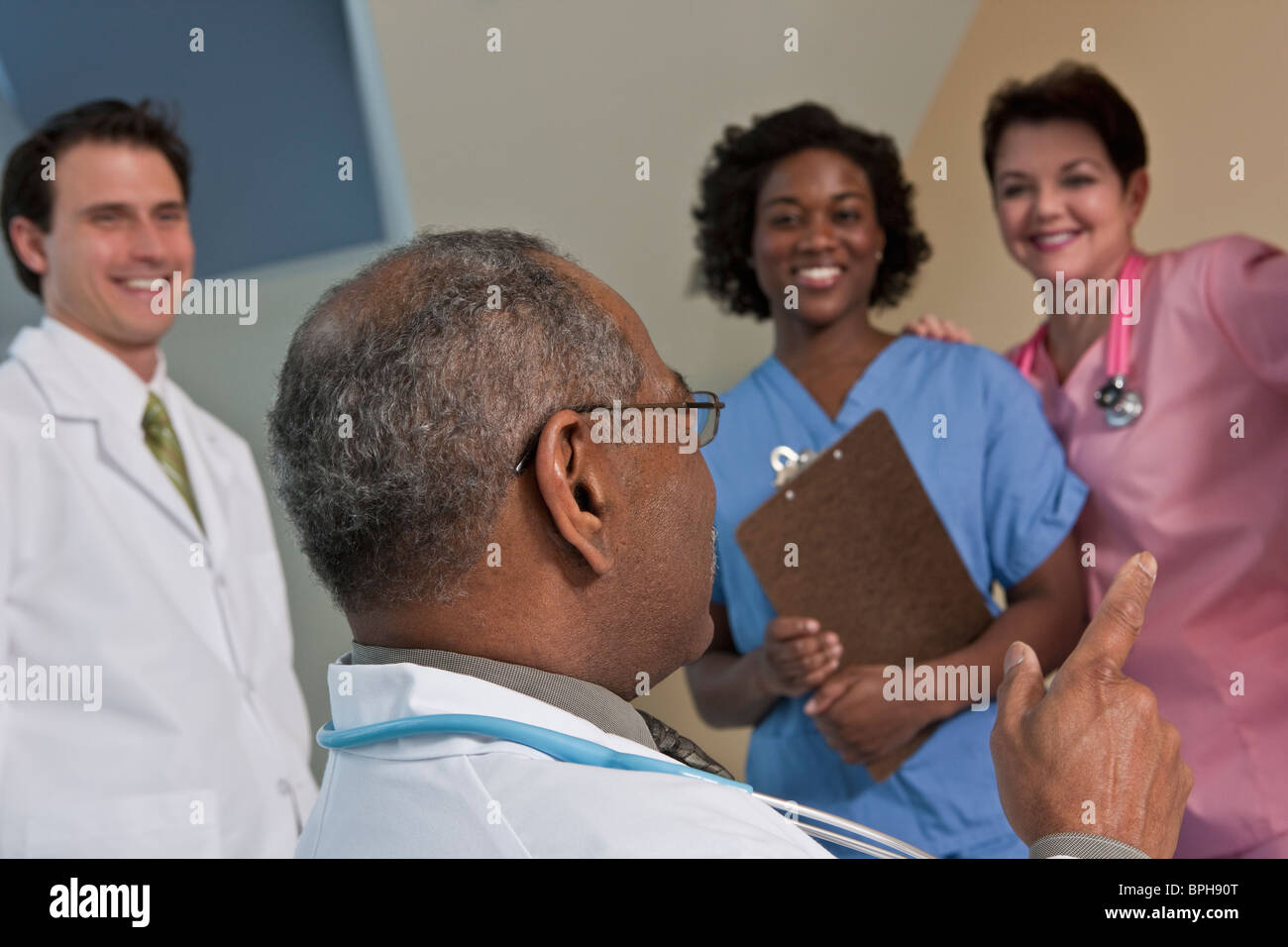 Doctor with his colleagues in a hospital - Stock Image