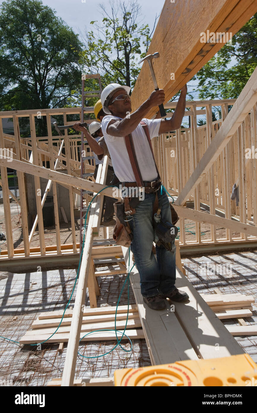 Carpenters working at a construction site Stock Photo