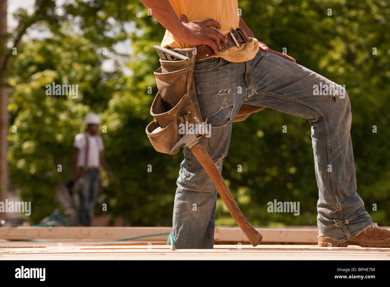 Carpenter standing at a construction site Stock Photo