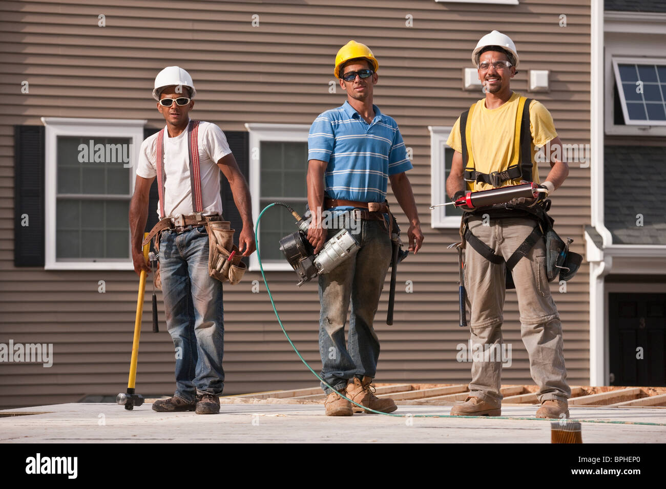 Carpenters working with construction tools - Stock Image
