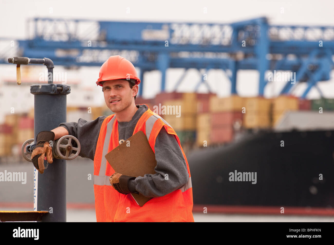 Transportation engineer working on a commercial dock - Stock Image