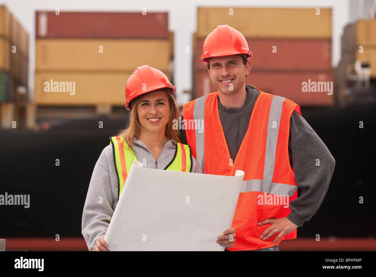 Transportation engineers holding a blueprint - Stock Image