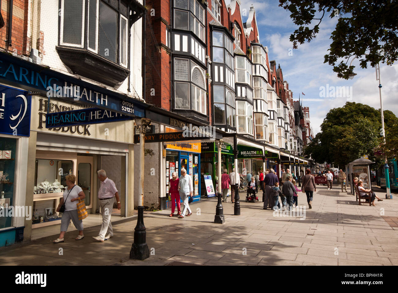 UK, England, Merseyside, Southport, Lord Street, shoppers on broad pavement in sunshine Stock Photo