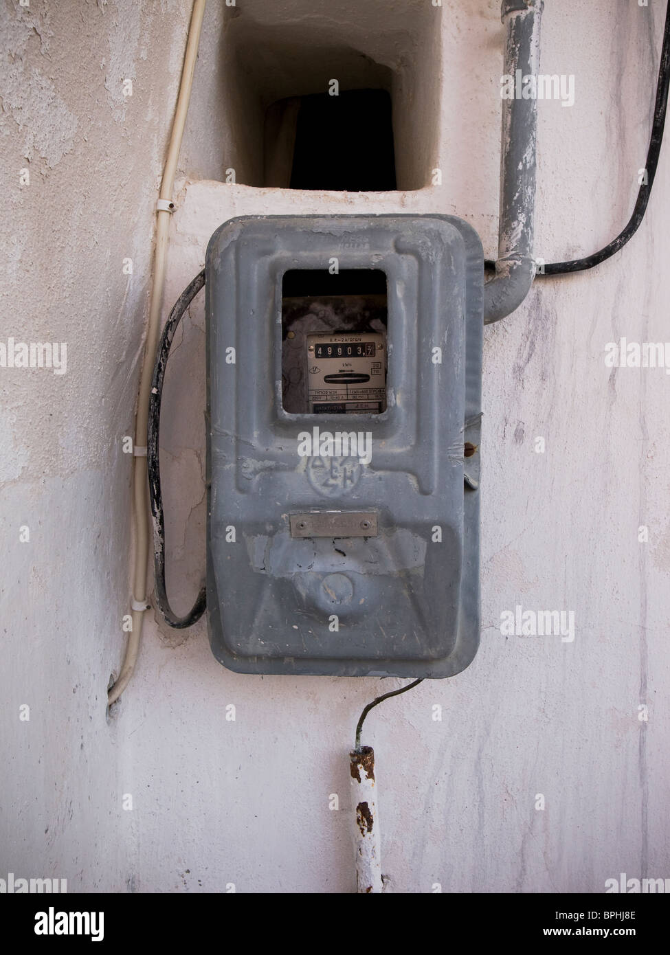 Electricity meter on wall in Greece - Stock Image