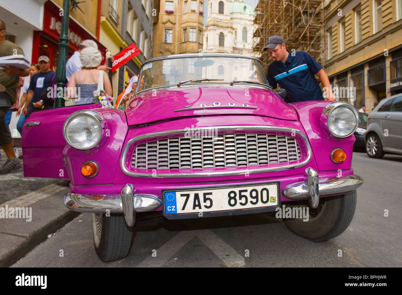 Old Skoda car parked in the Old Town in Prague. Used to take tourists on tours of the historical center. - Stock Image
