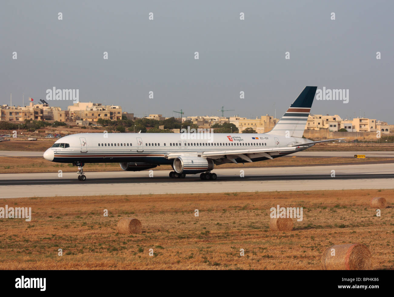 Privilege Style Boeing 757-200 charter plane on the runway during takeoff from Malta - Stock Image