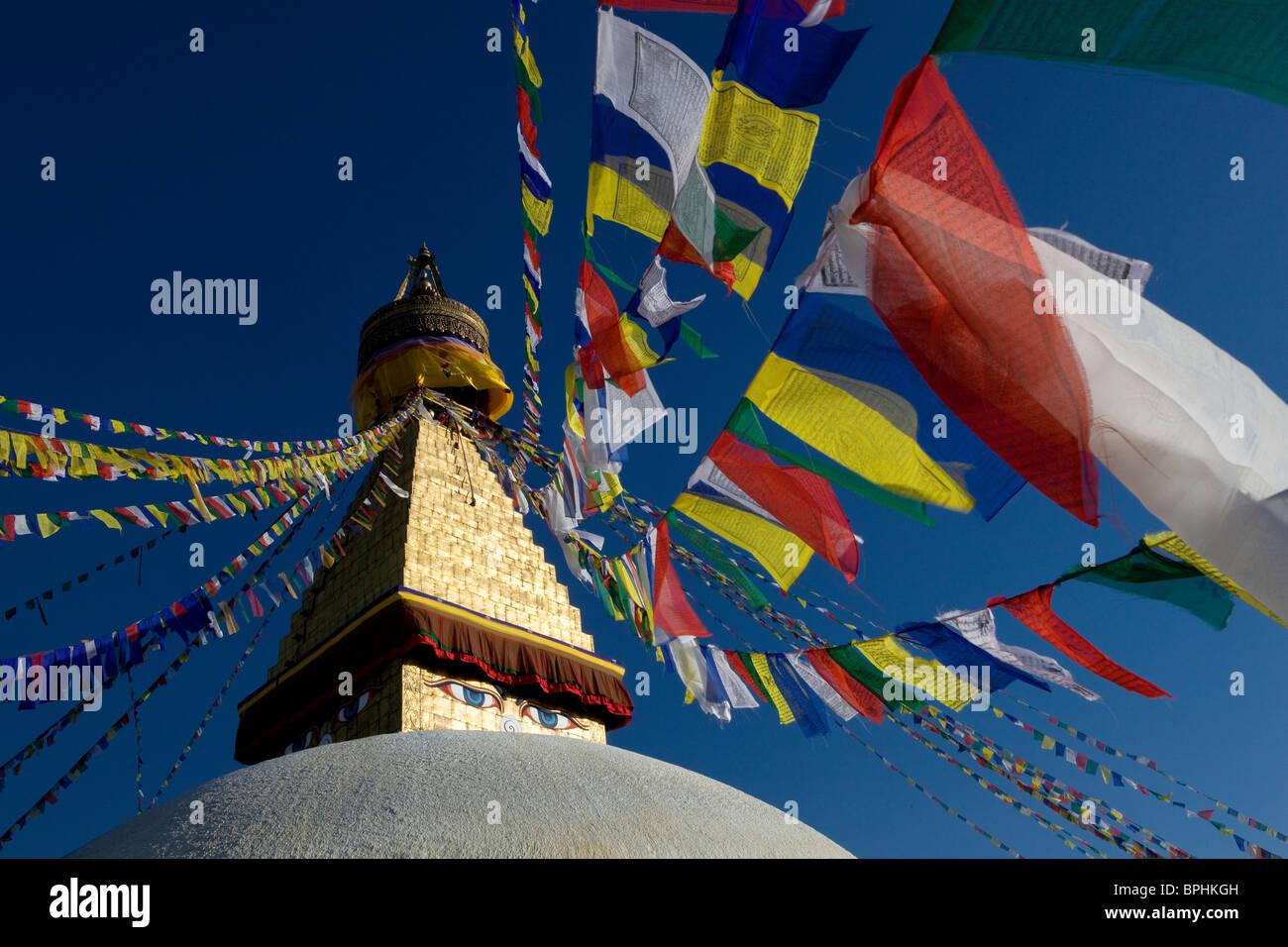 Bodnath Tibetan temple prayer flags Buddhism Kathmandu Nepal Asia - Stock Image