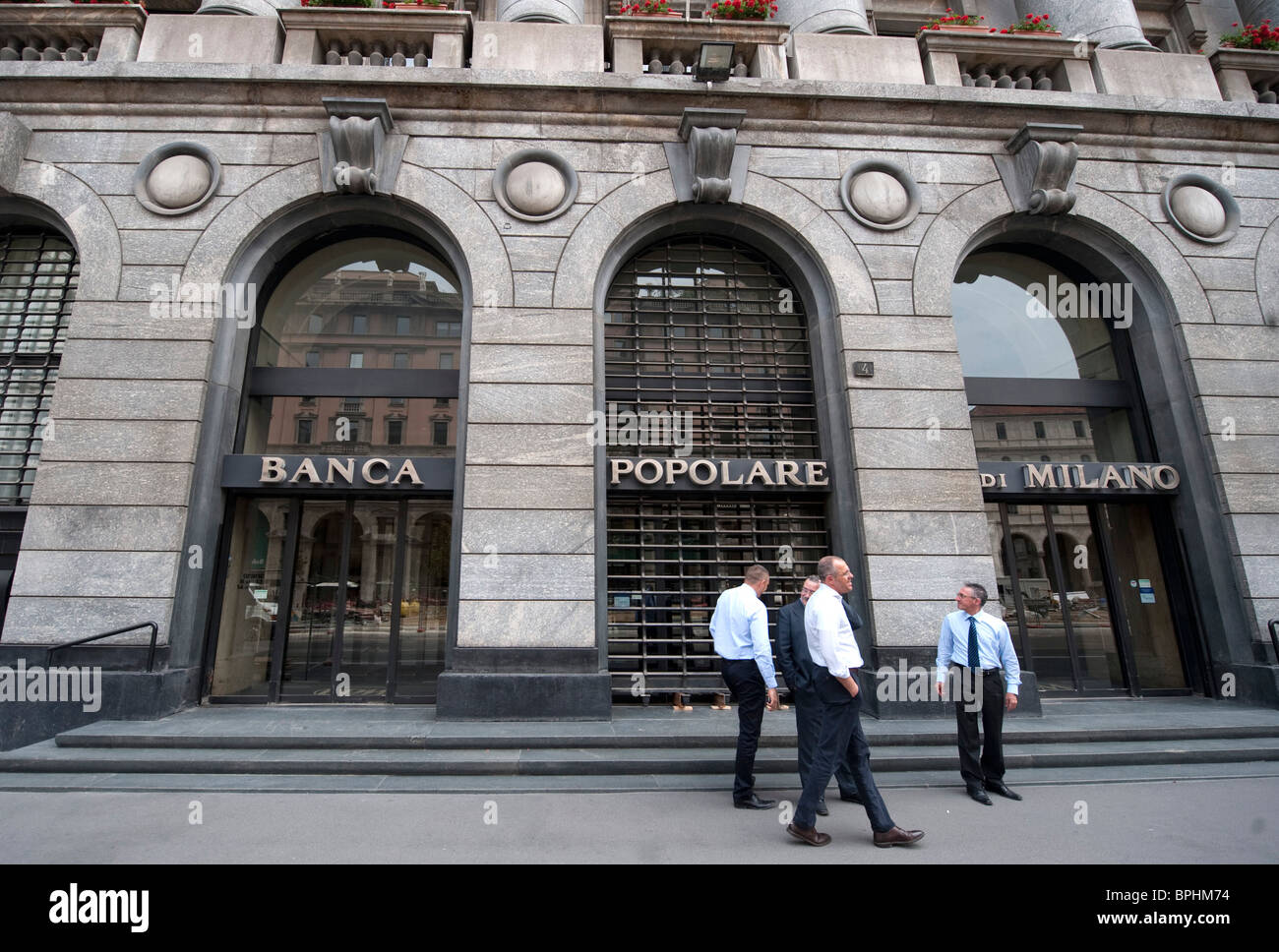 Employees Outside A Branch Of Banca Popolare Di Milano Milan Italy