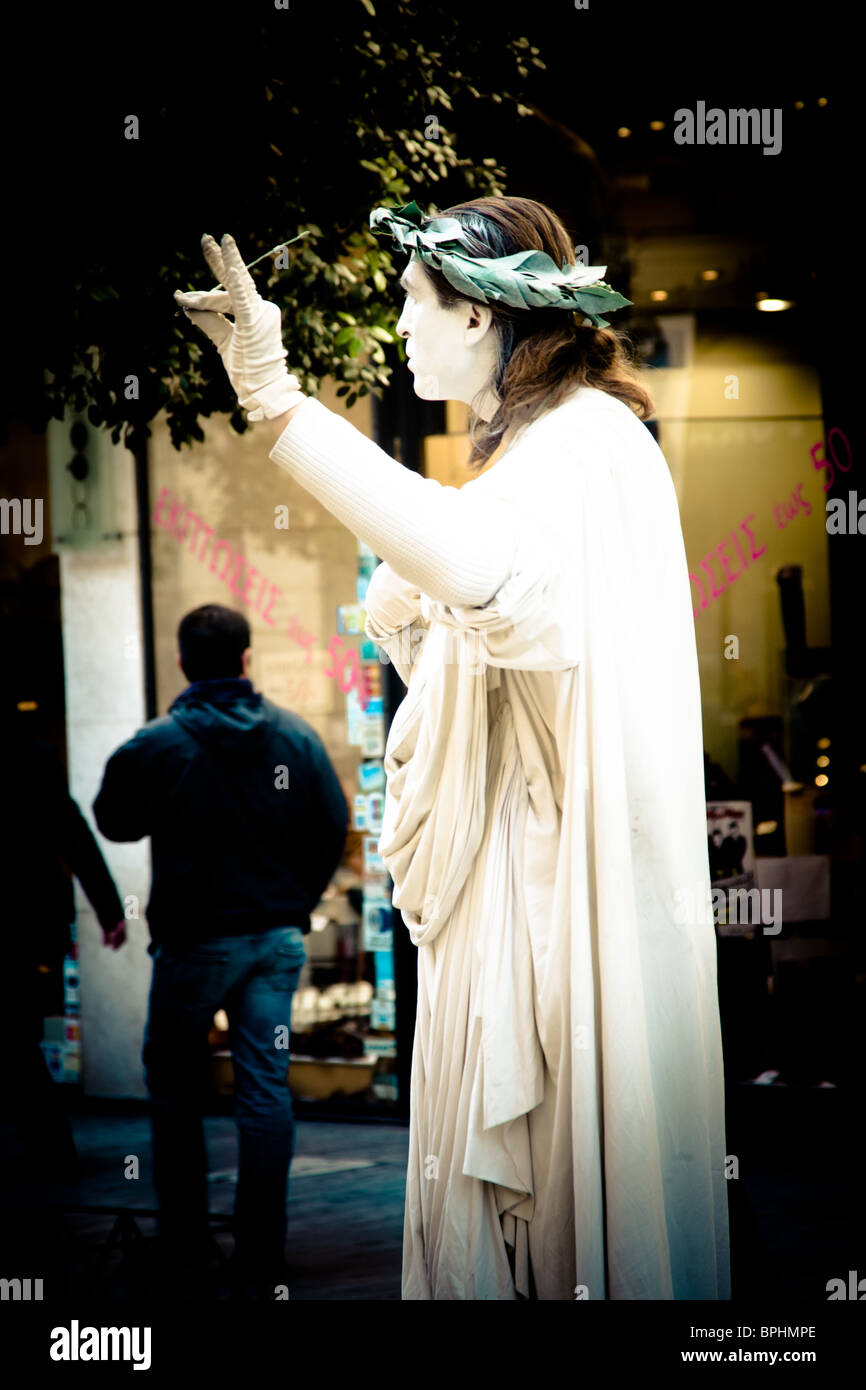 Human statue in downtown Athens, Greece. - Stock Image