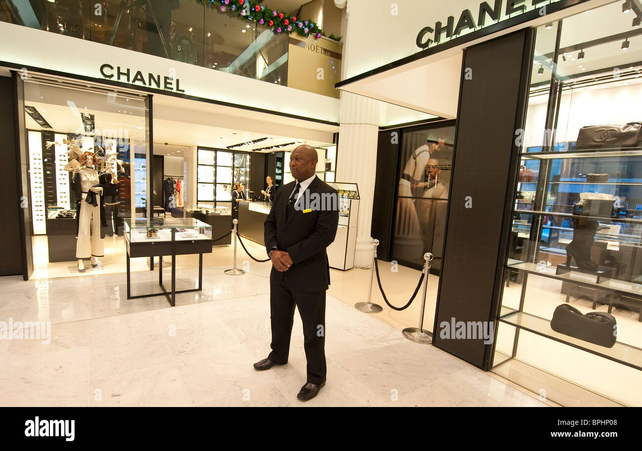 5bf3a23fd5a0 Security personnel at the Chanel boutique inside Selfridges London - Stock  Image