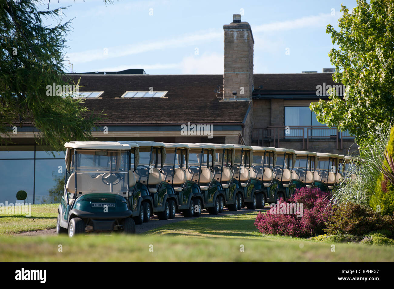 Golf buggies lined up outside the Roman Road clubhouse at the Celtic Manor hotel, Newport. Venue for the 2010 Ryder - Stock Image