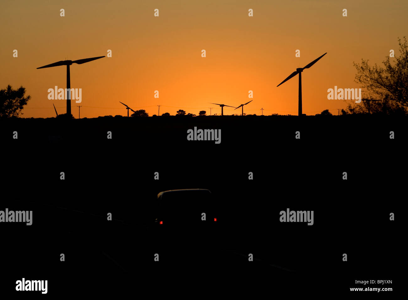 Cold Northcott wind farm, Cornwall. Turbines silhouetted against sunset. - Stock Image
