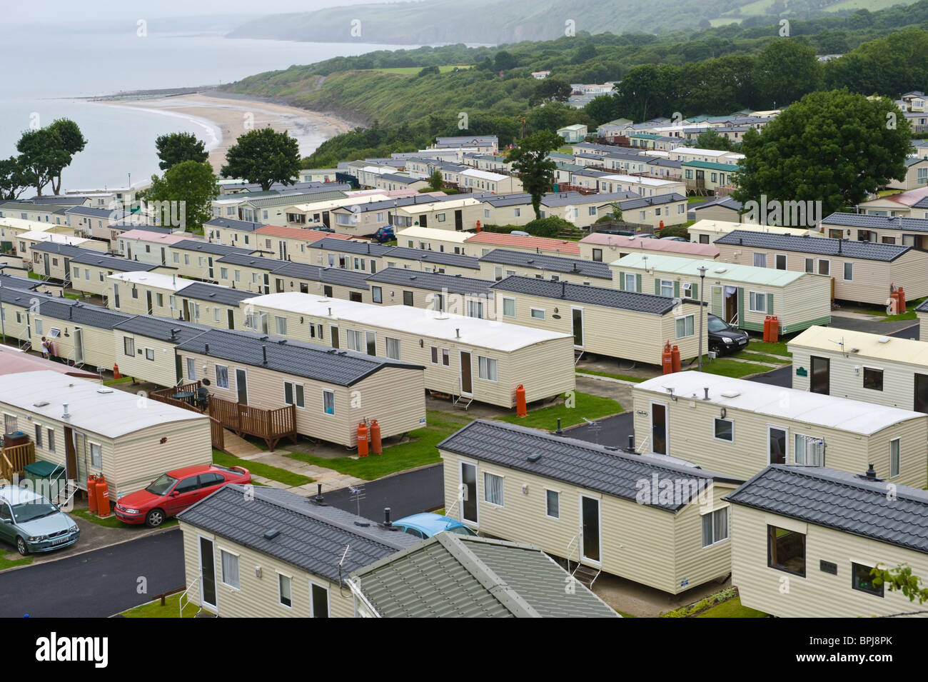 Caravan park of family holiday caravans outside the seaside town of New Quay Ceredigion West Wales UK - Stock Image