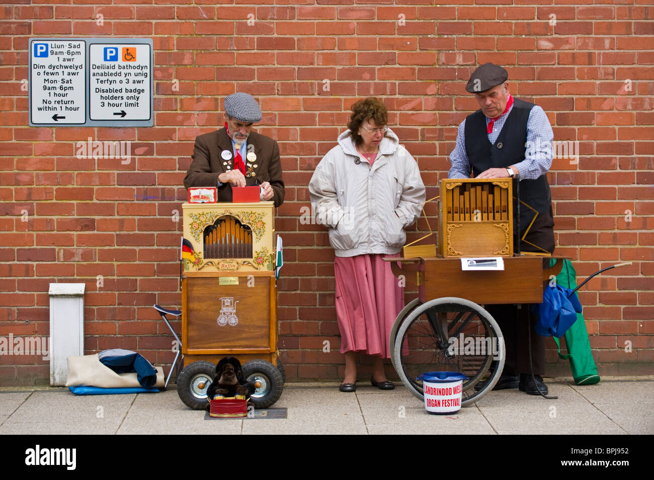 Organ grinders in period costume playing street organs at the Victorian Festival in Llandrindod Wells Powys Mid - Stock Image