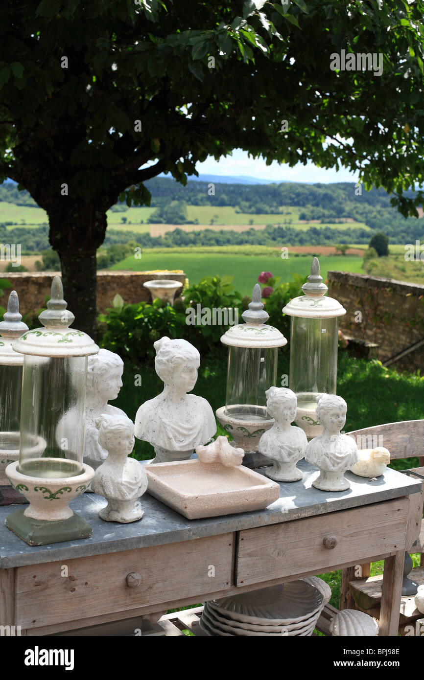Display of Pottery and Jars on a Terrace overlooking the Morvan Regional Park in France. - Stock Image
