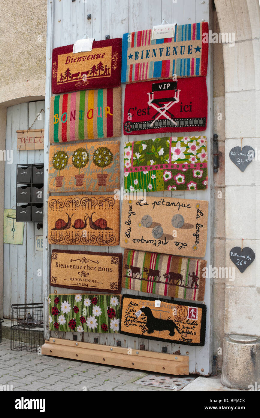 Doormats On Display Outside A Shop In The French Village Of Vezelay.