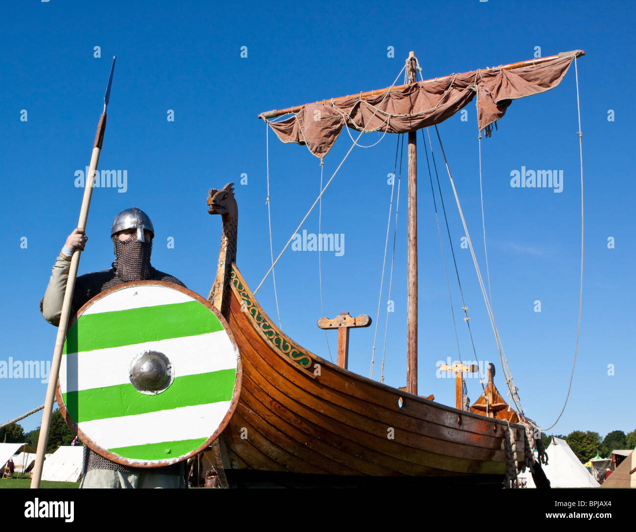 Viking Longboat and Warrior with Spear and Shield - Stock Image