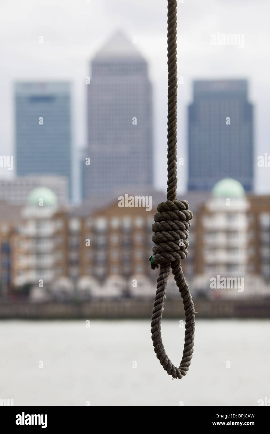 Noose hanging in front of Canary Wharf Development London UK - Stock Image