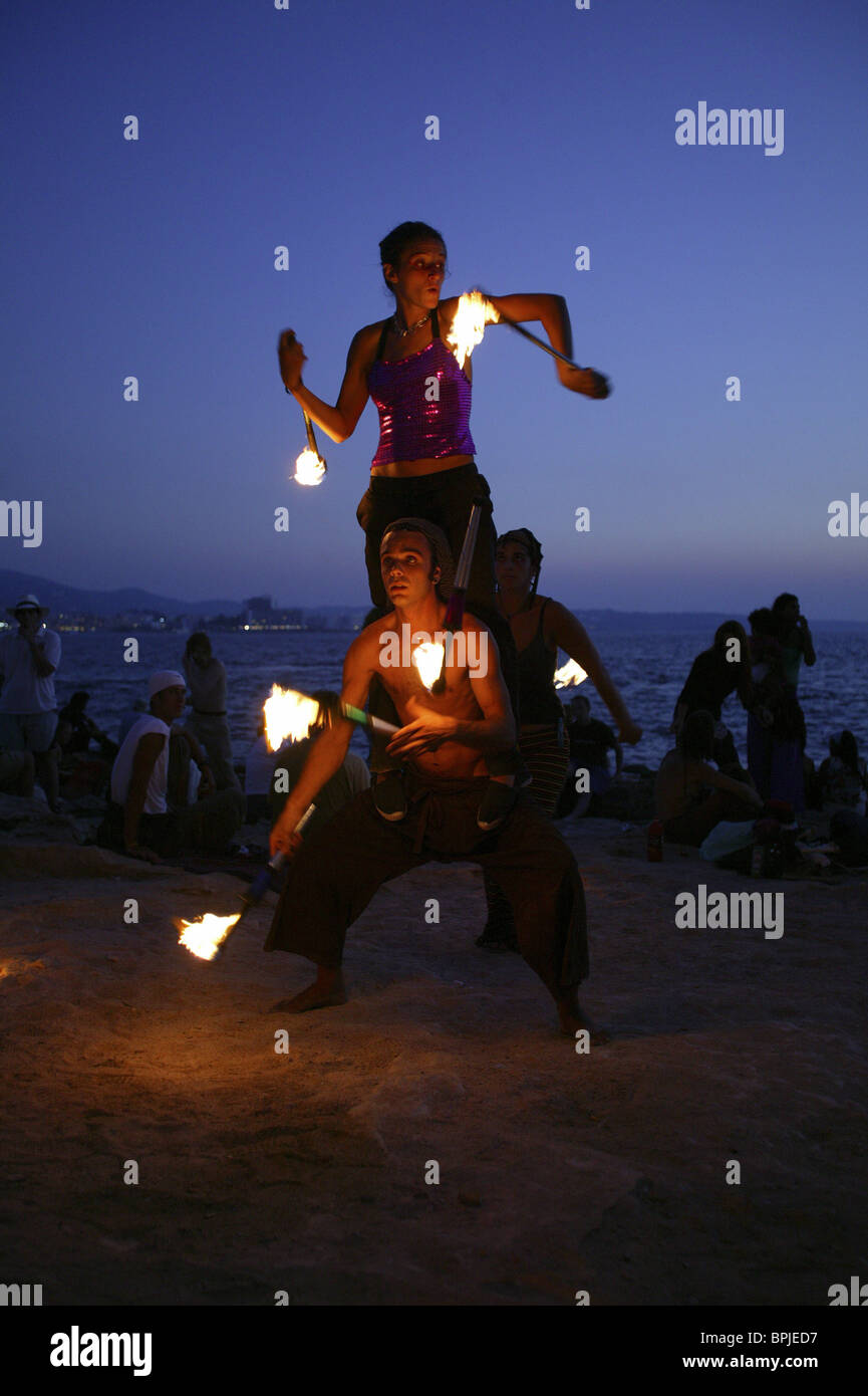 Jugglers and fire-eaters at Café del Mar Ibiza, Balearic Island, Spain - Stock Image