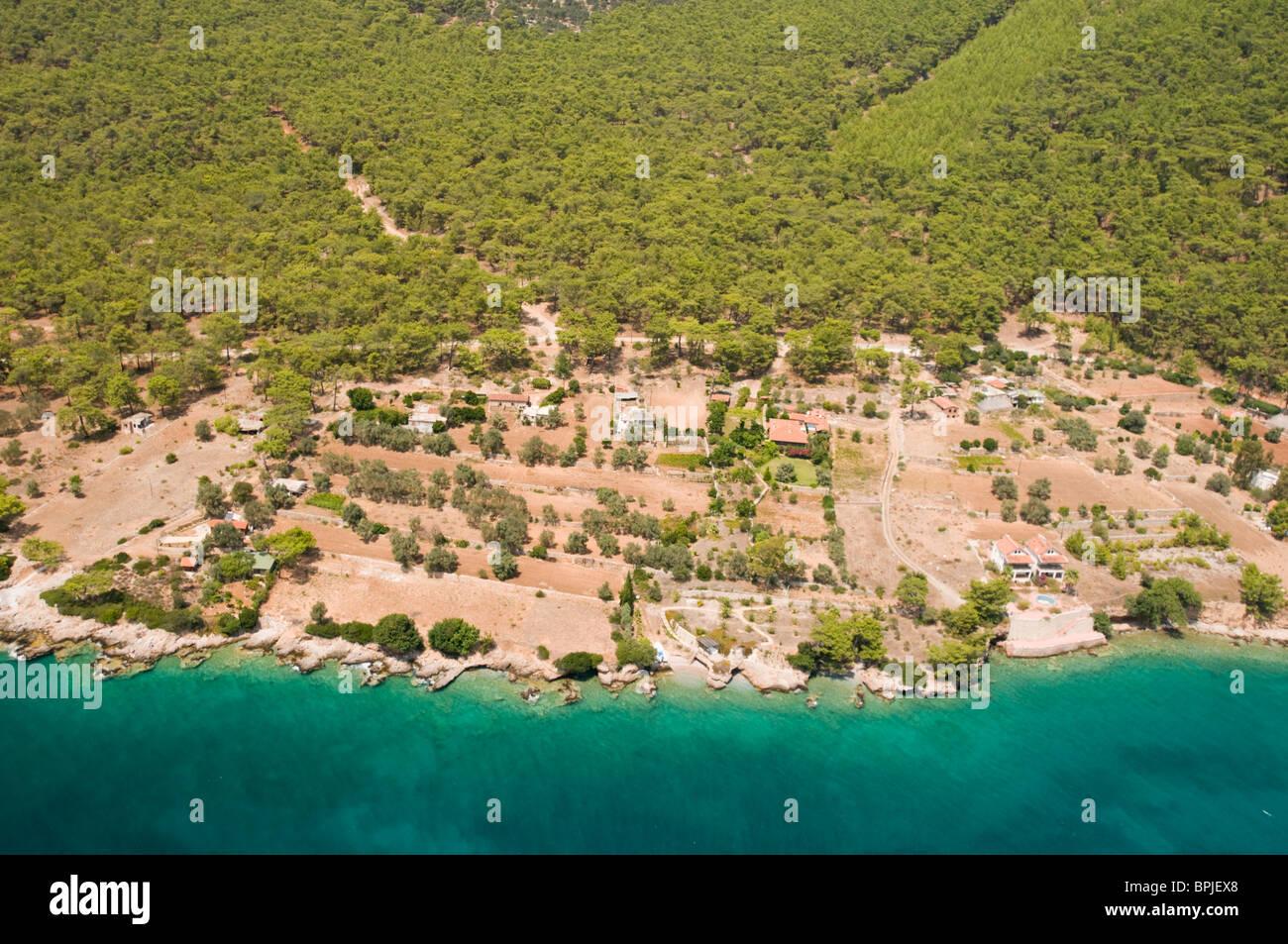 Aerial view of human impact on coastal forest cover Gokova Turkey - Stock Image
