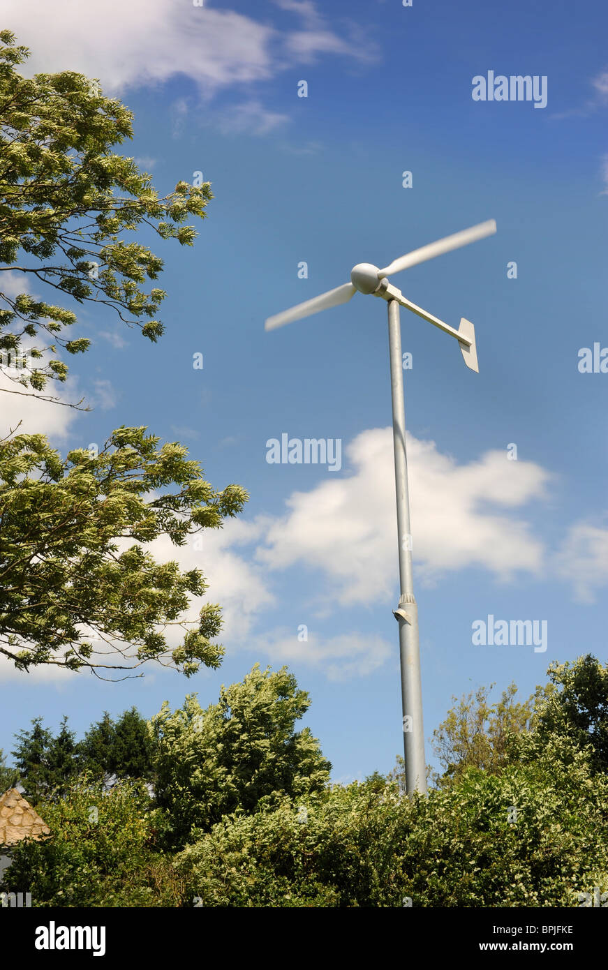 A wind turbine in the garden of a family home in Buckinghamshire UK - Stock Image