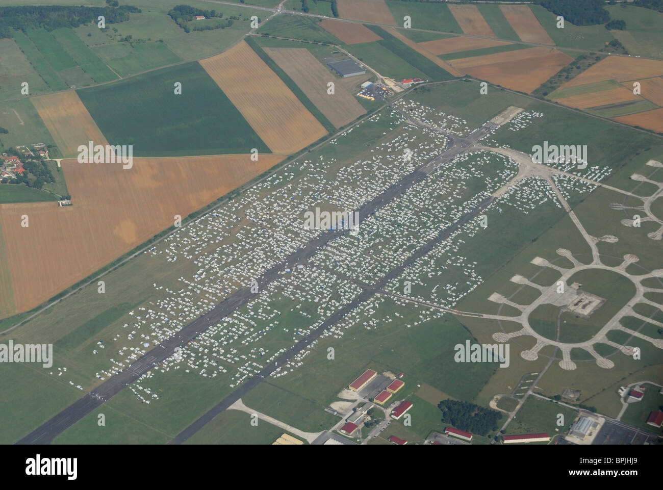 Aerial view of airport of Chaumont occupied by 25 000 gypsies  (20/8/010), Haute Marne, Champagne-Ardenne region, - Stock Image