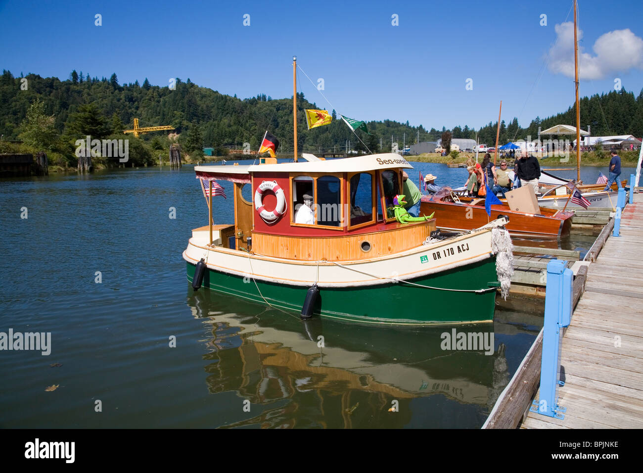 Wooden boats on the Yaquina River at an annual Wooden Boat show in Toledo, Oregon Stock Photo