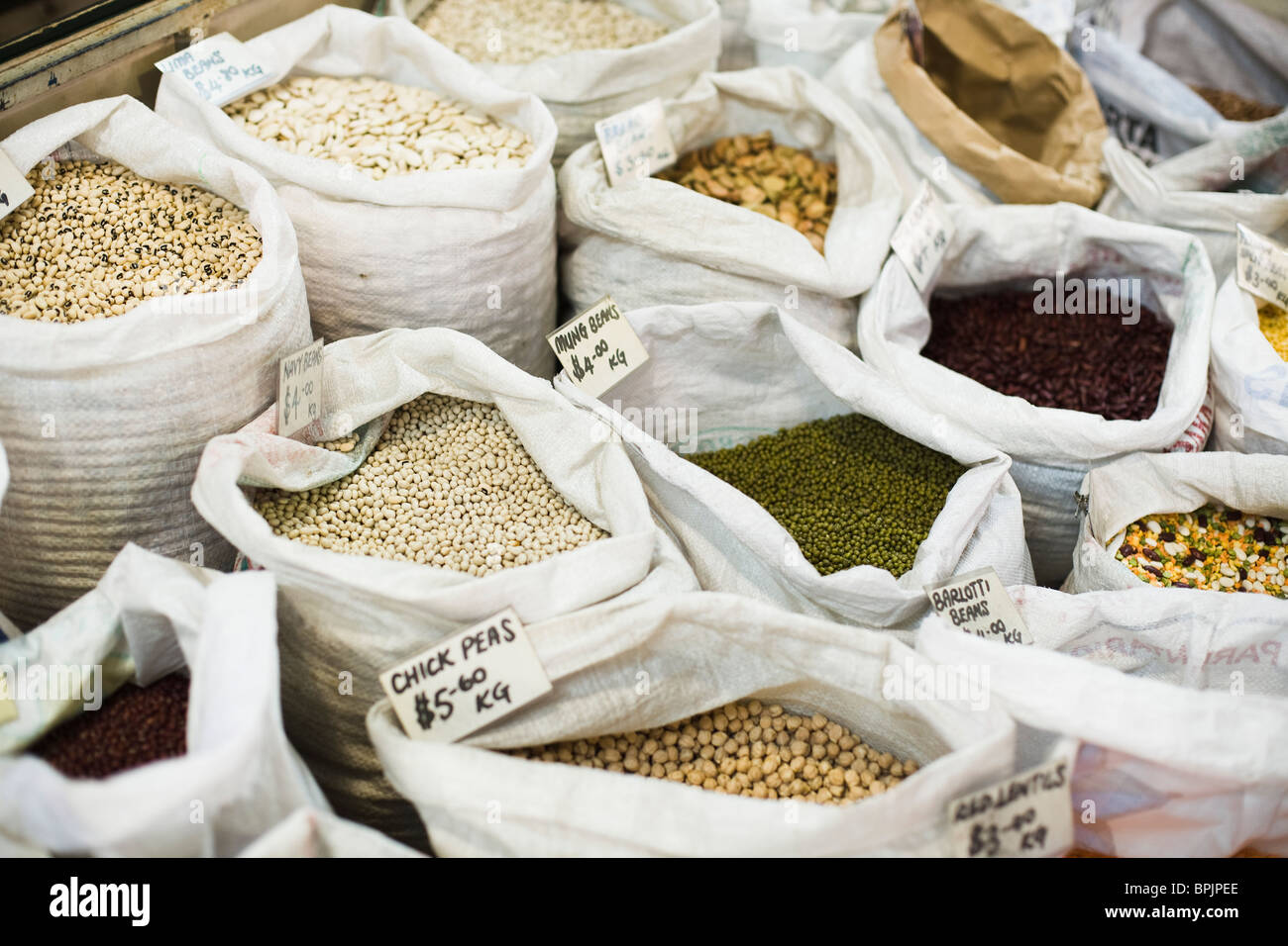 Sacks of beans being sold in a open market - Stock Image