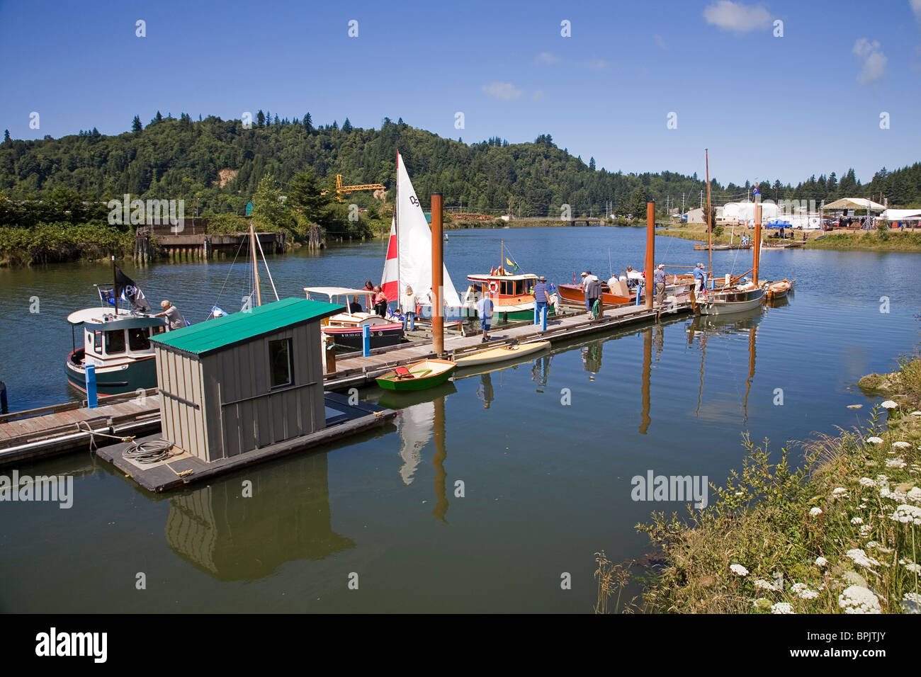 Wooden boats on the Yaquina River at an annual Wooden Boat show in Toledo, Oregon - Stock Image