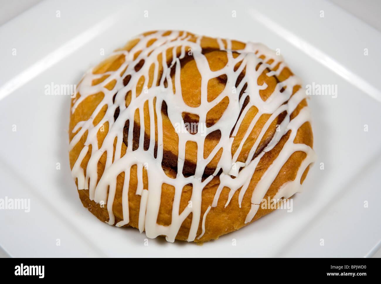 Tastykake iced cinnamon danish. - Stock Image
