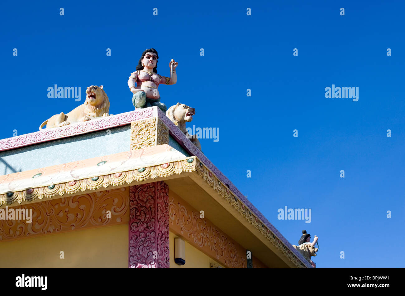 Temple Indian deity figure with lions, roof detail , Mauritius - Stock Image