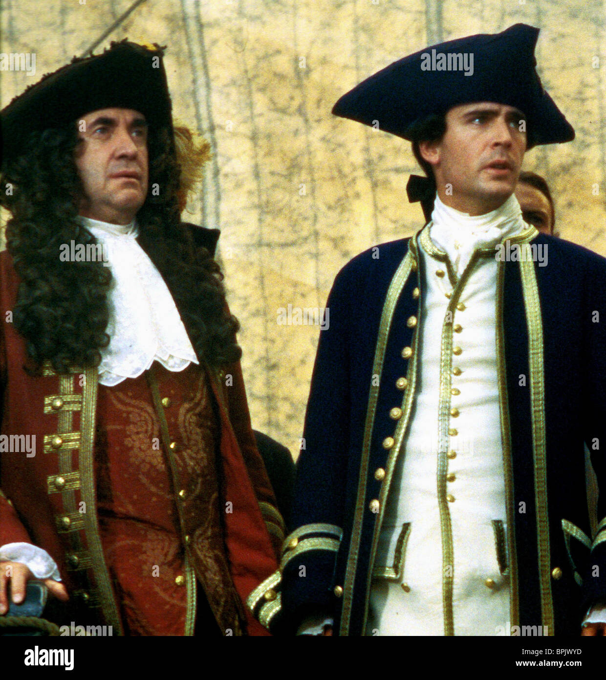 JONATHAN PRYCE & JACK DAVENPORT PIRATES OF THE CARIBBEAN: THE CURSE OF THE BLACK PEARL (2003) Stock Photo