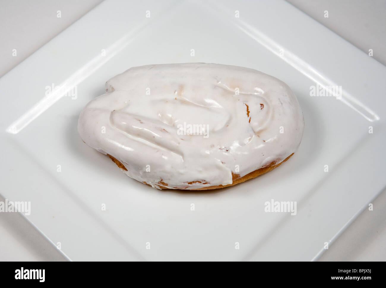 Tastykake iced honey bun. - Stock Image