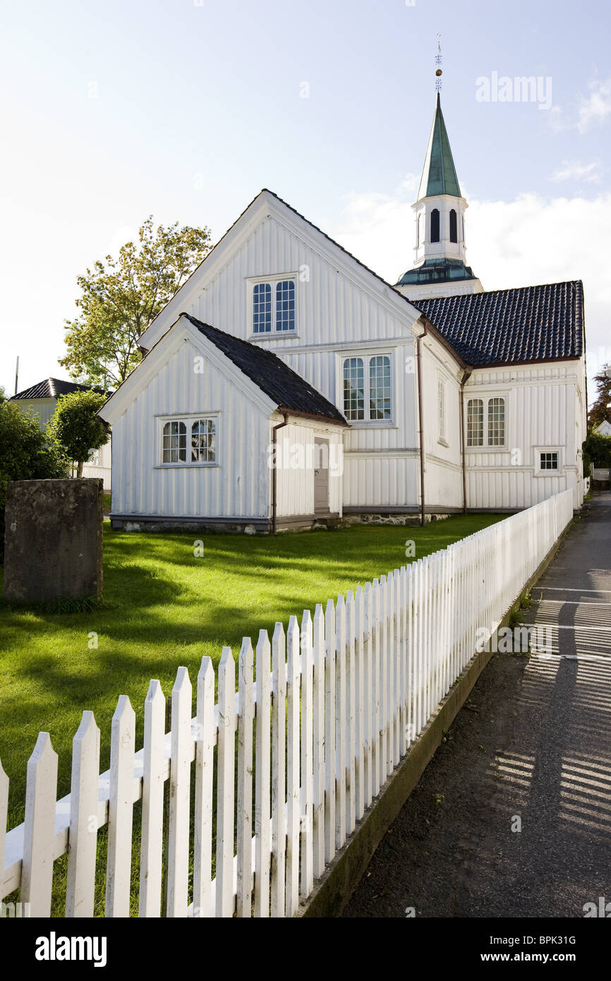 Wooden fence and church at Risor, Skagerrak, Sorland, Norway, Scandinavia, Europe - Stock Image