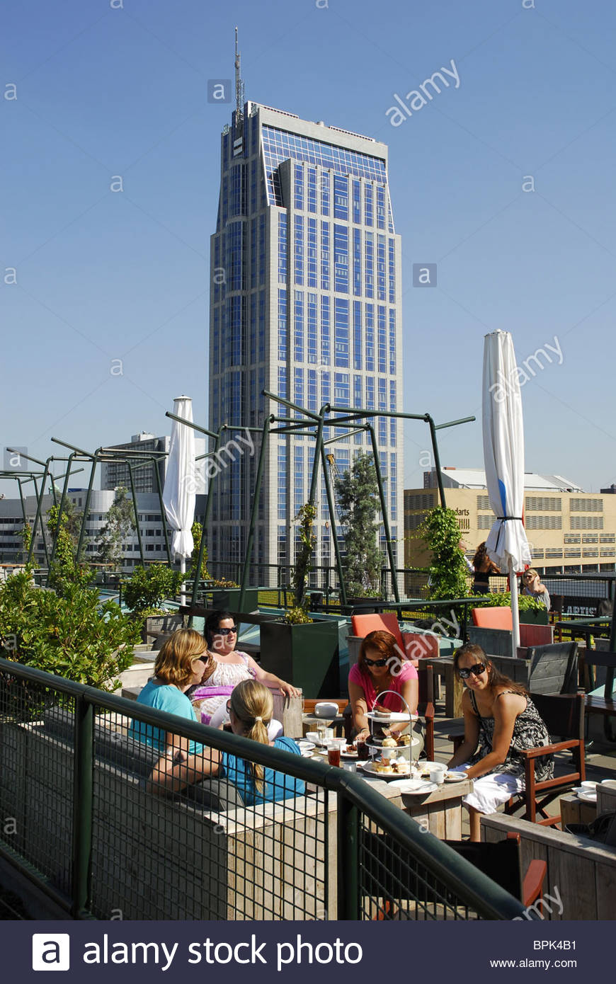 Modern architecture, women at grand cafe restaurant Engels on the roof terrace of the Groothandelsgebouw building, Stock Photo