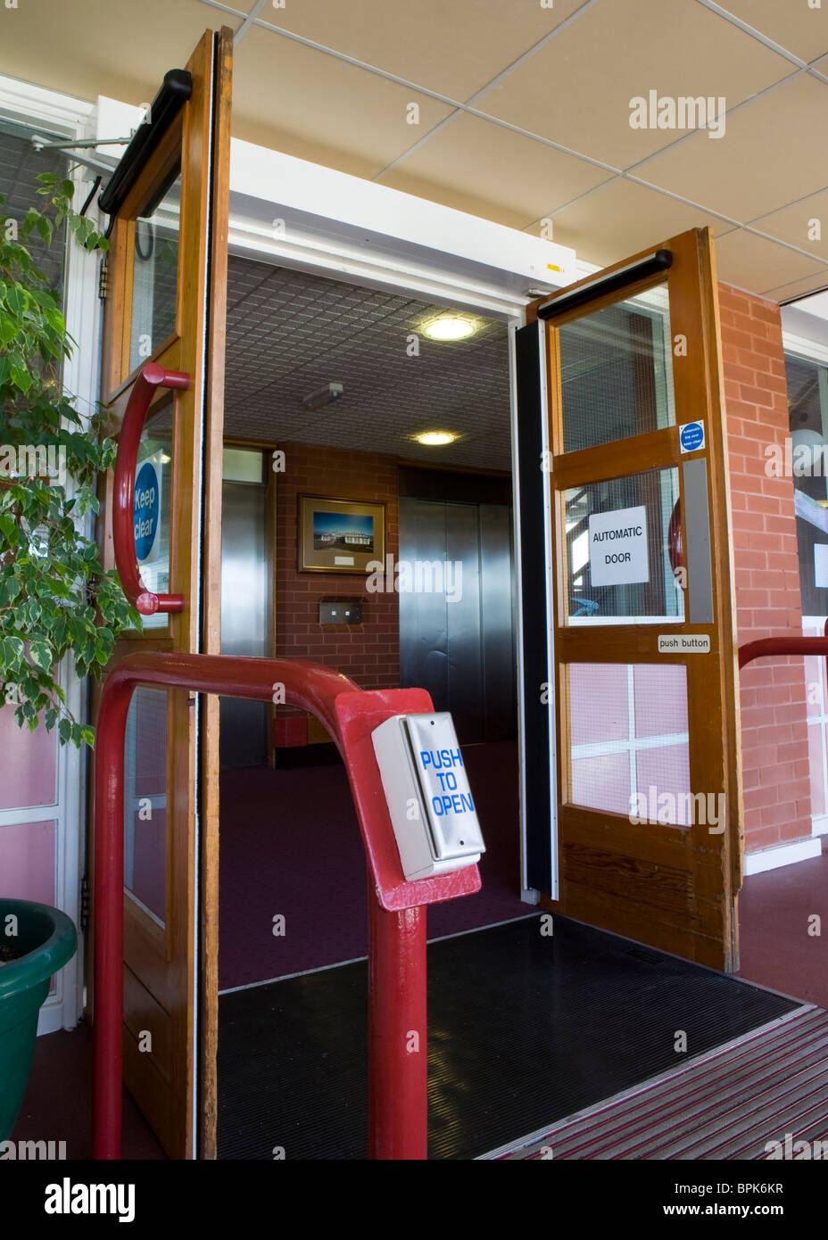 Disability access _Entrance Doors at Vitalise Respite Care Centre, Southport, Merseyside, UK - Stock Image