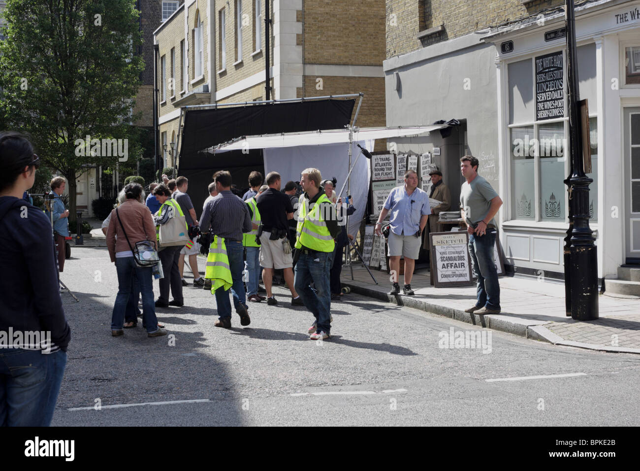 Film crew and cast in York Street and George Street, London during filming period drama of Edward and Mrs Simpson. - Stock Image