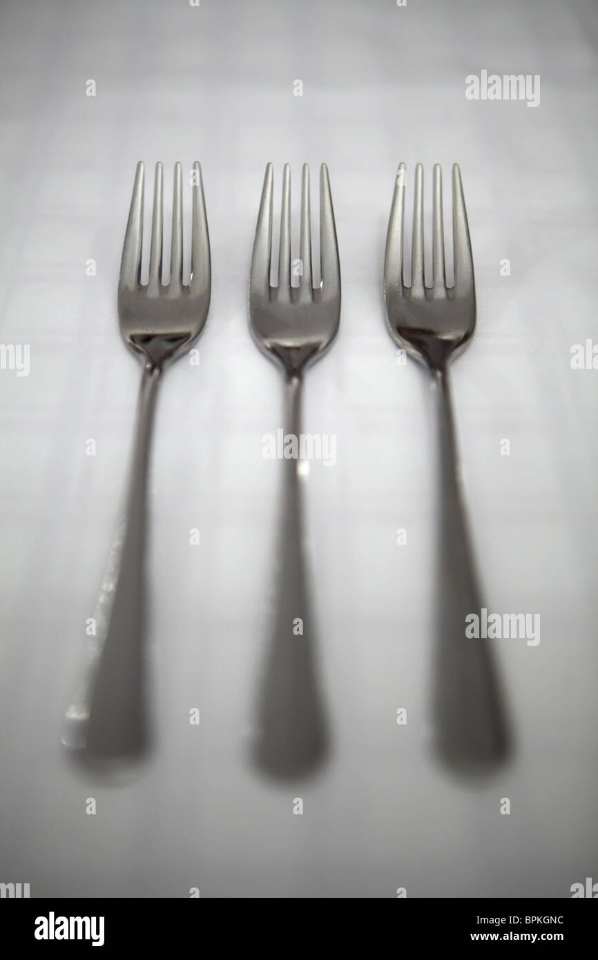 three forks on a tablecloth - Stock Image
