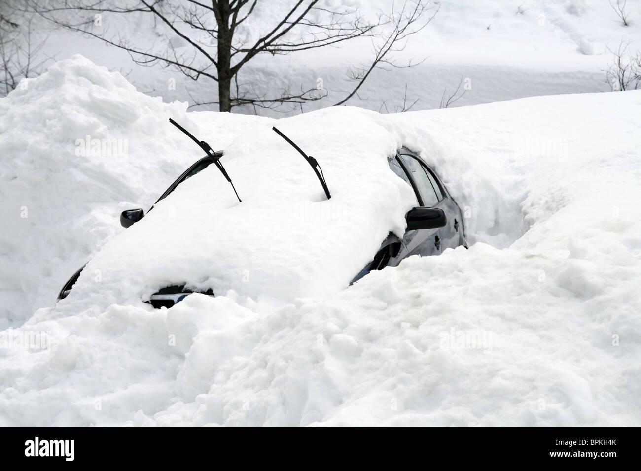 Car under snowdrift - Stock Image