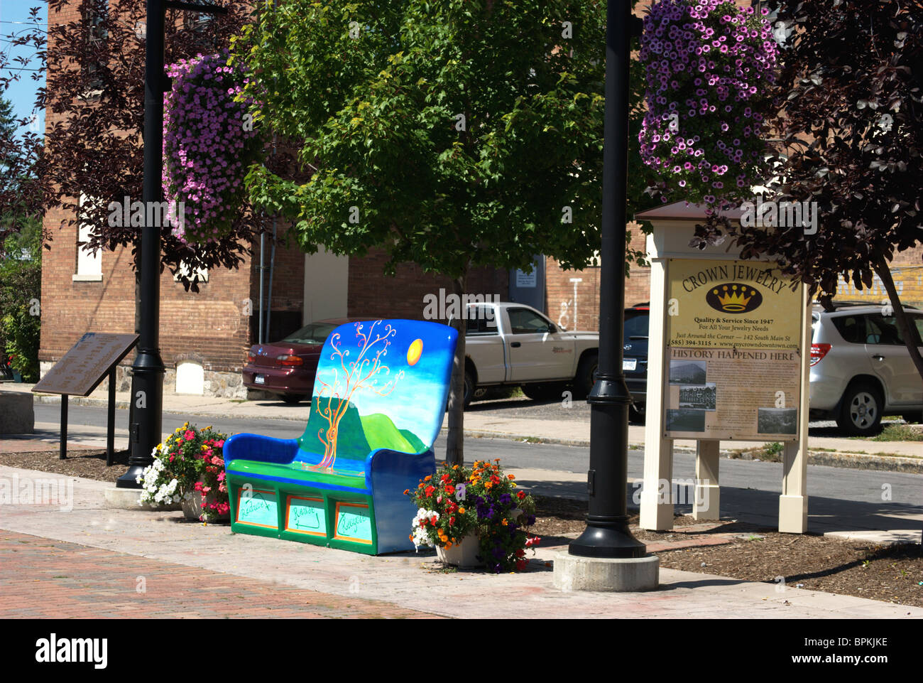 Primitive painted one-off bench design street furniture - Stock Image