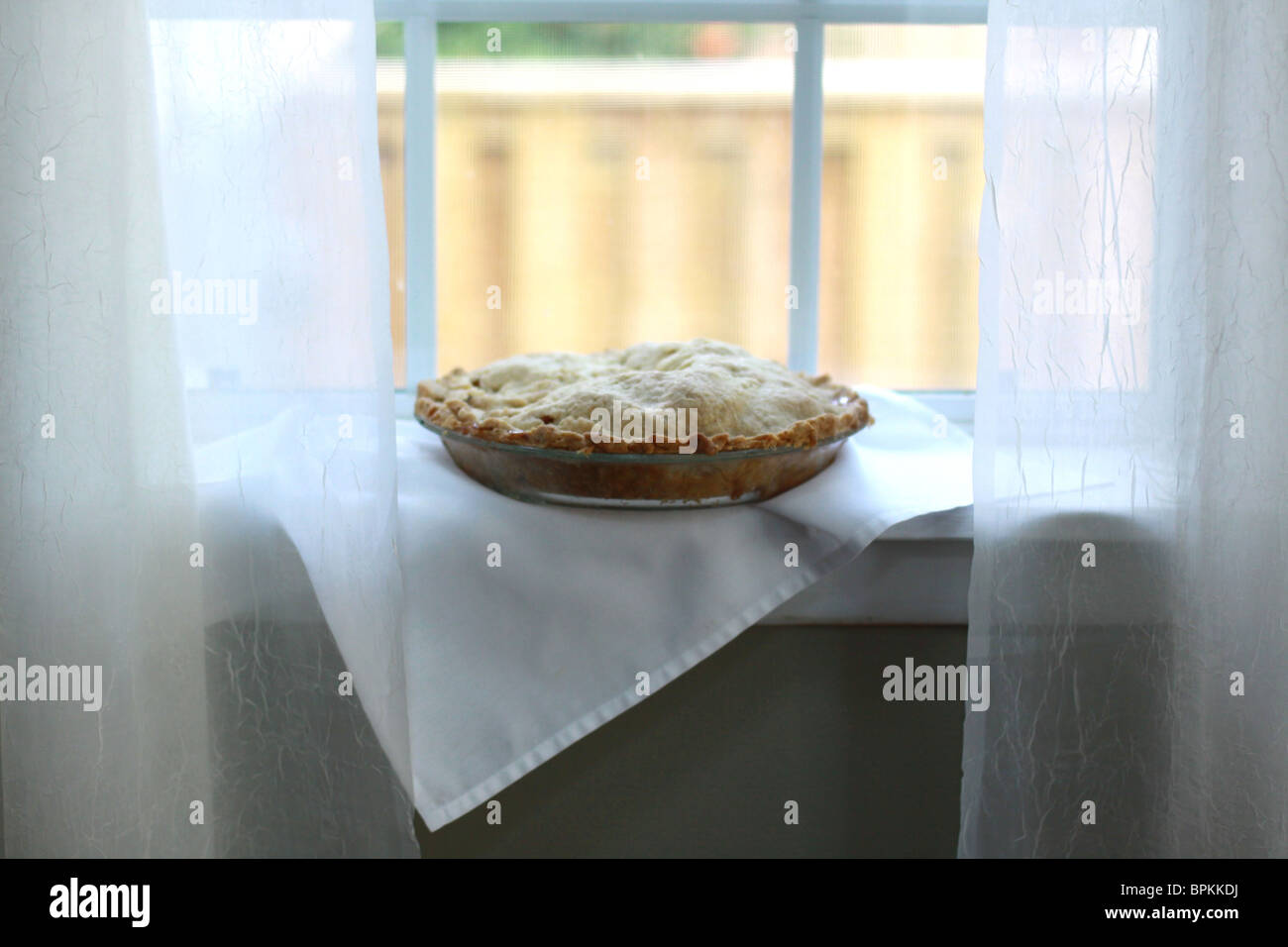 An Apple Pie Cooling On A Window Sill