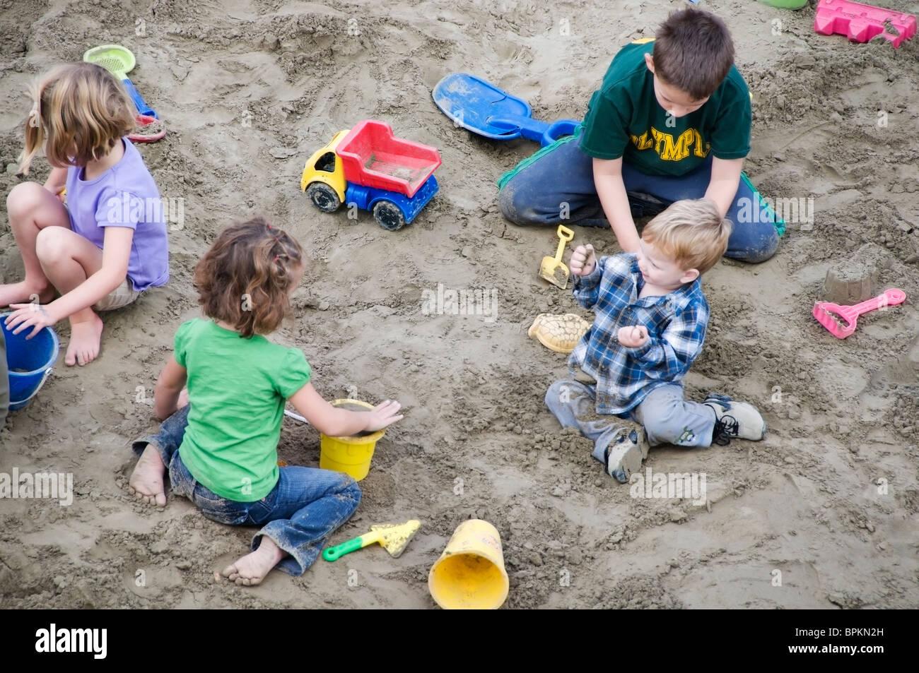 kids in sandbox stock photos kids in sandbox stock. Black Bedroom Furniture Sets. Home Design Ideas