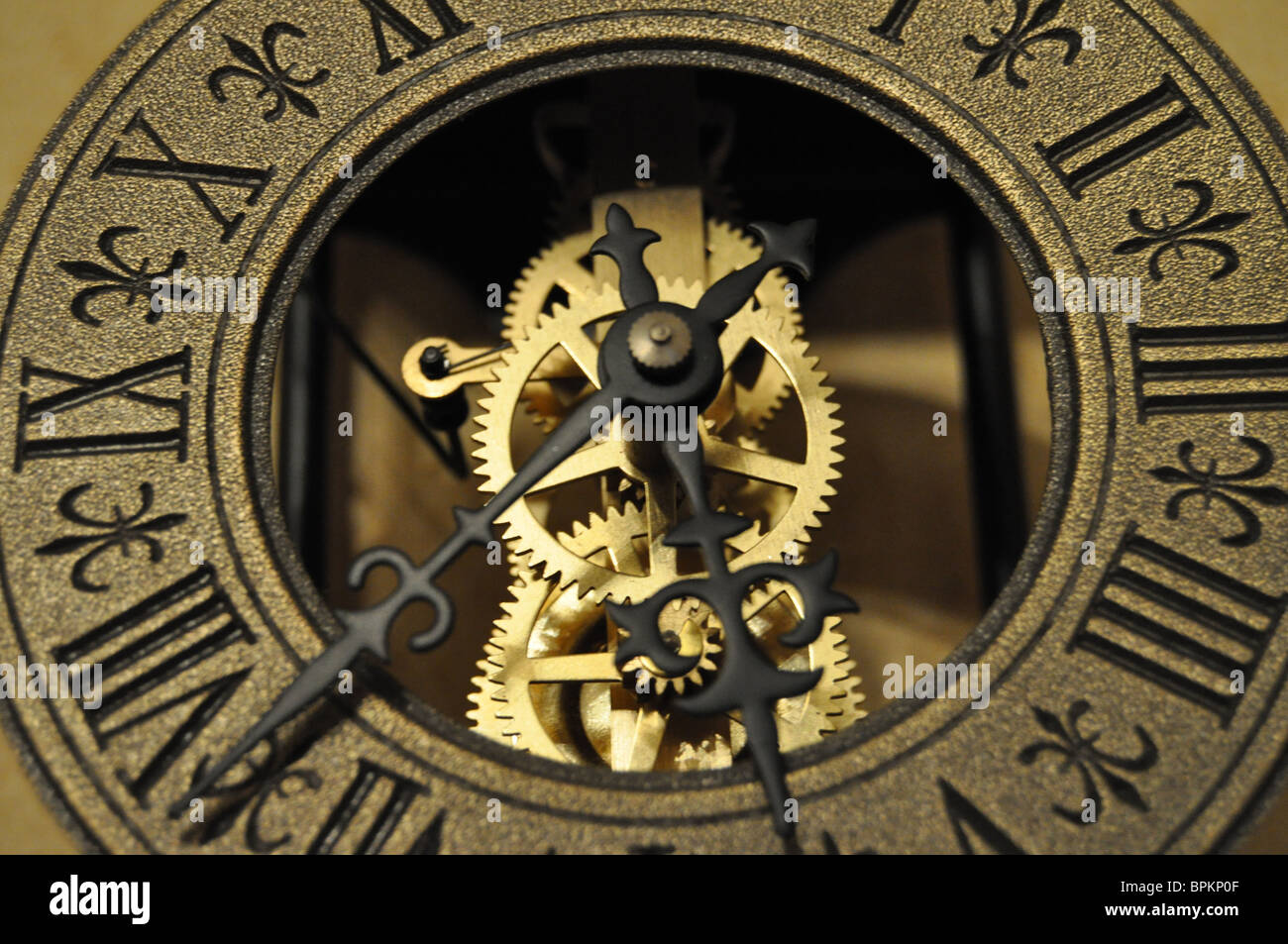 close up of a skeleton clock showing its gears stock photo