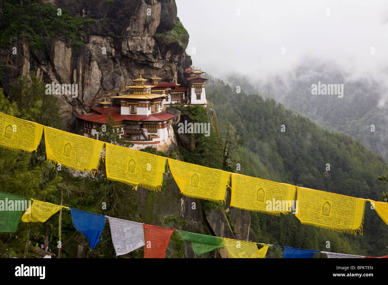Taksang known as Tiger's Nest said to be where saint Guru Padmasambhava flew from the region of Tibet on the - Stock Image