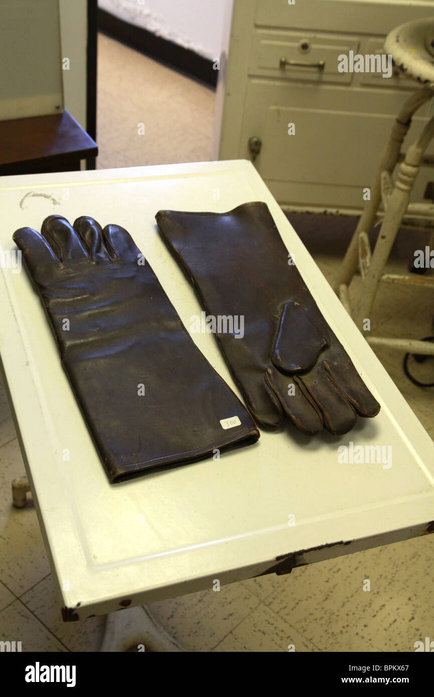 A display of leather gloves at the Glore Psychiatric Museum. - Stock Image