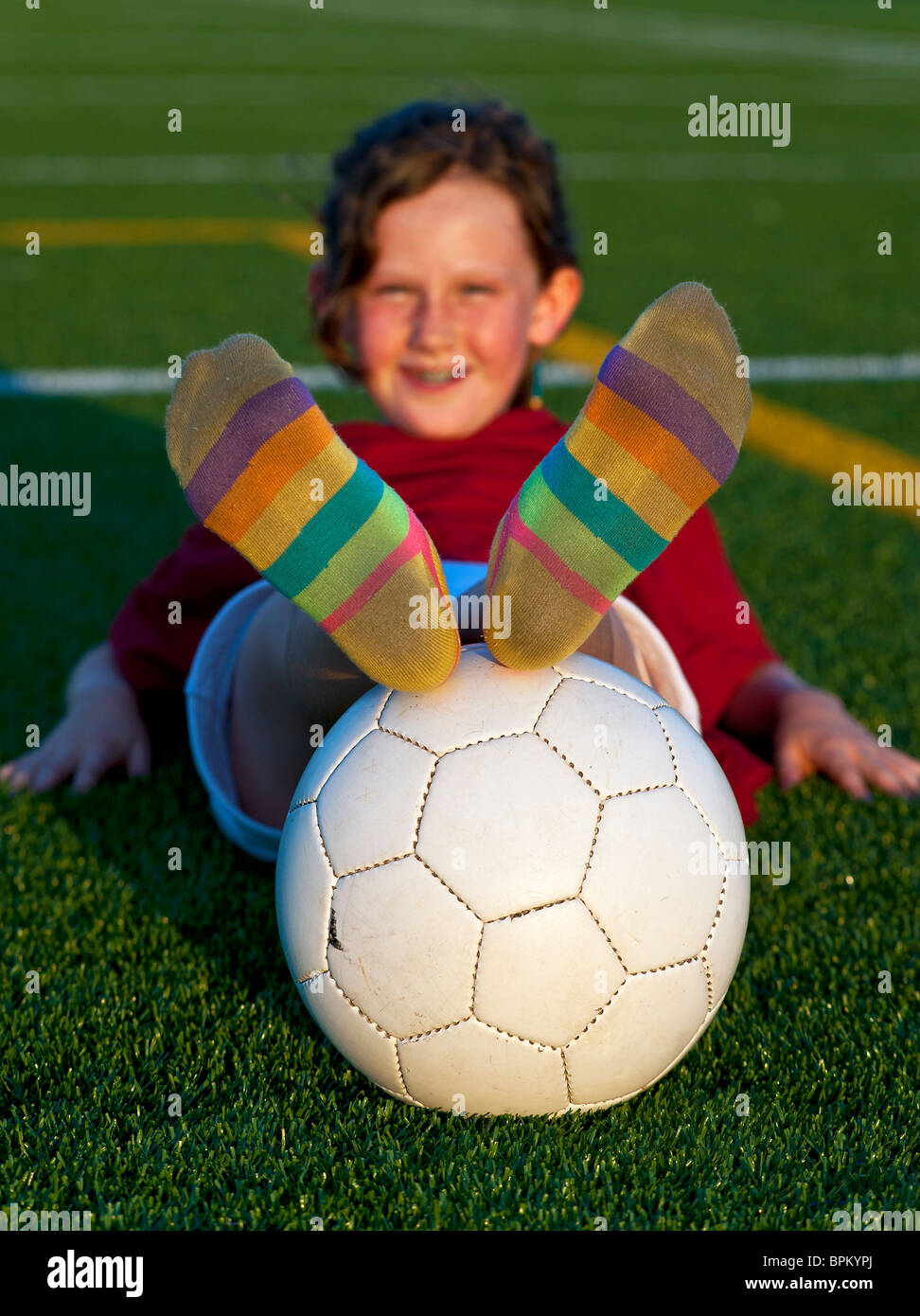Portrait of girl with soccer ball. - Stock Image