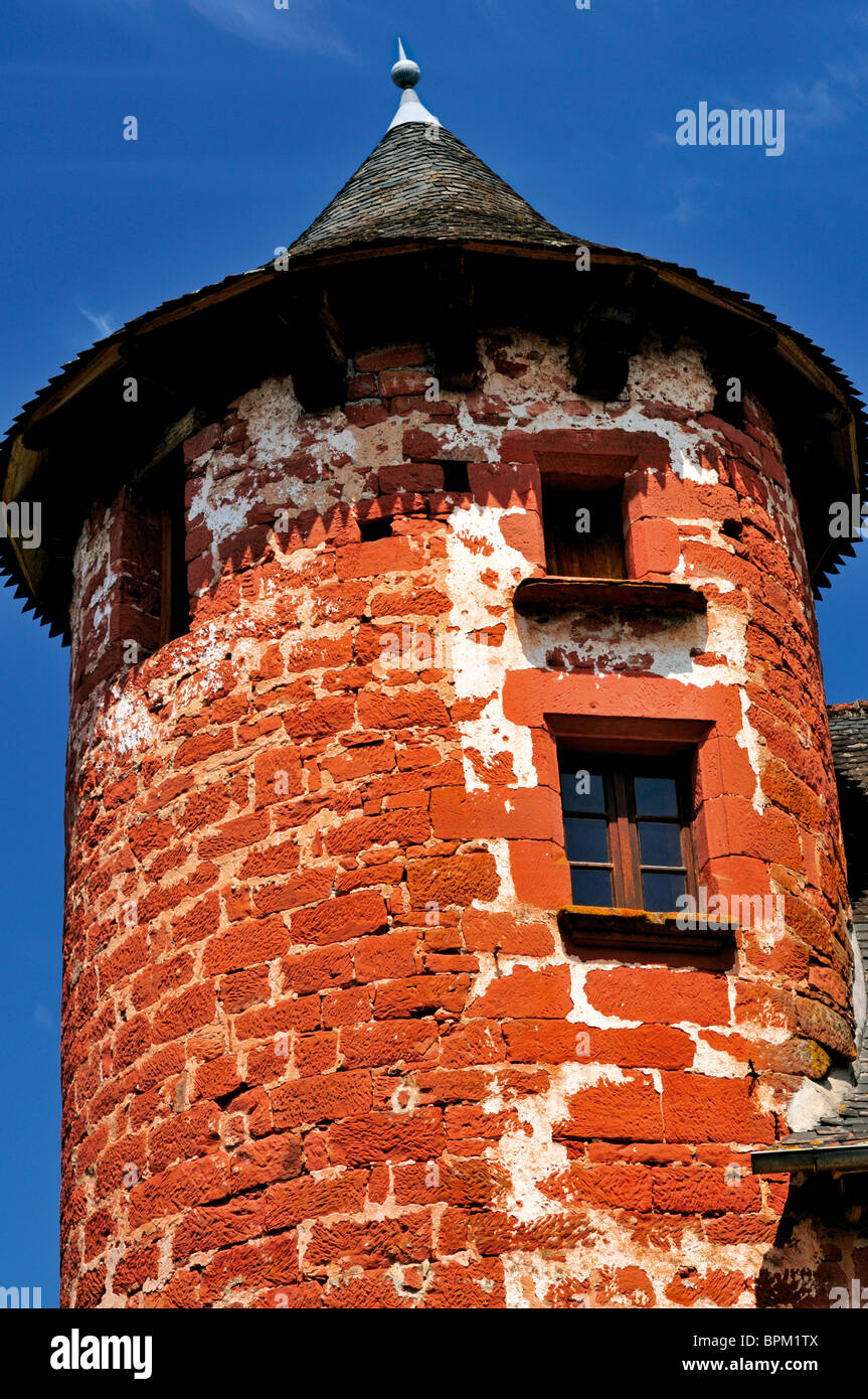 France: Red sand stone tower in Collonges-la-Rouge - Stock Image