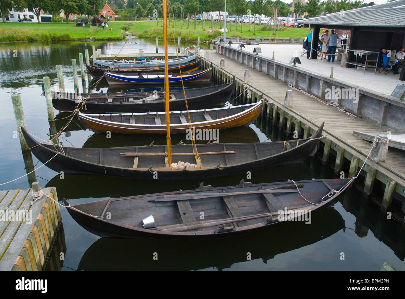 Viking ear replica boats at the harbour of Roskilde Fjord lake Roskilde Denmark Europe Stock Photo