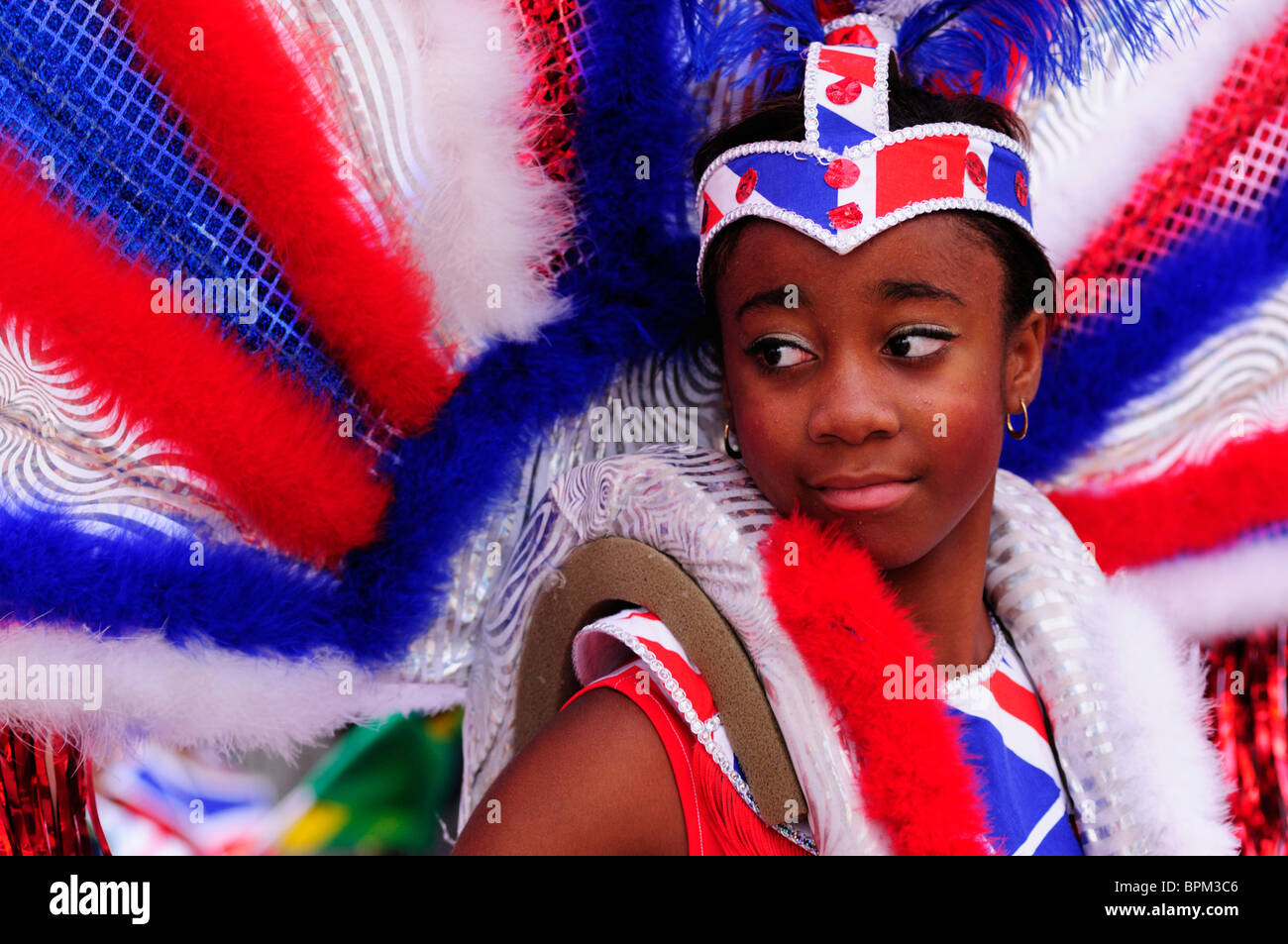 Portrait of a girl dancer at the Notting Hill Carnival Children's Day Parade, London, England, UK - Stock Image